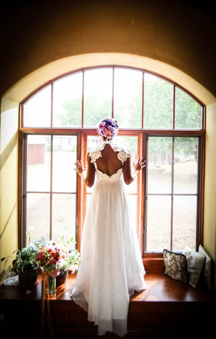 bride silhouette in farmhouse window