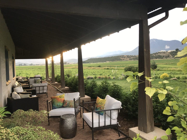 Farmhouse patio lounge area with a mountain view