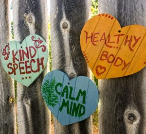 Healthy body, Calm Mind Kind Speech - text in hearts on a wall